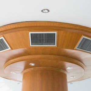 What are the advantages of a ducted system over room wall splits?